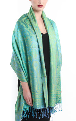 luxurious mint green and blue  paisley designed elegant silk pashmina with tassels draped around shoulders