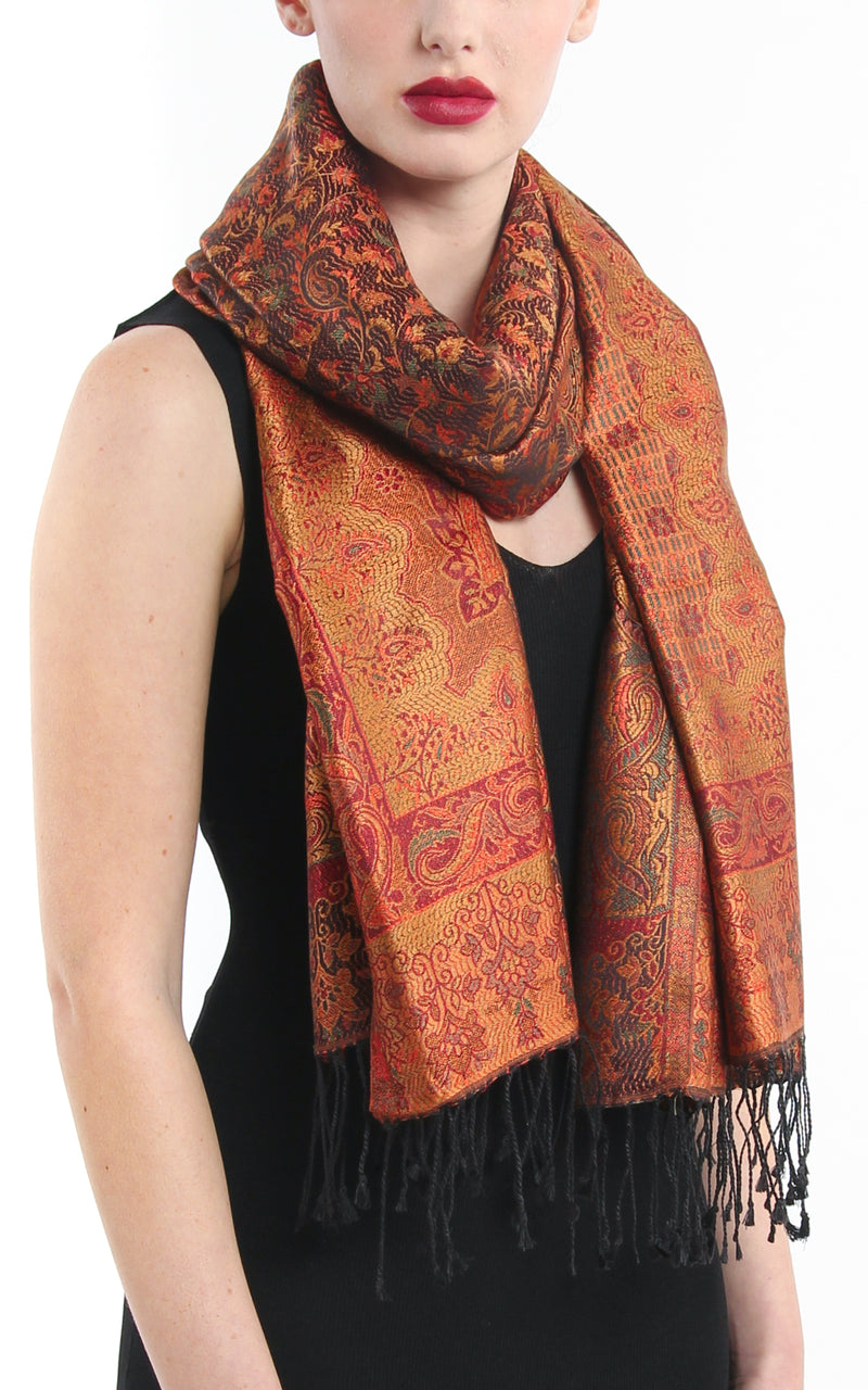 Burnt orange luxury pure silk reversible paisley patterned pashmina with tassels styled around neck