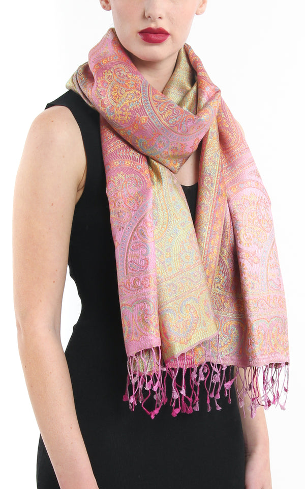 Pale Pastel Pink Paisley patterned pure reversible silk pashmina with  gold accents and tassels styled around necj