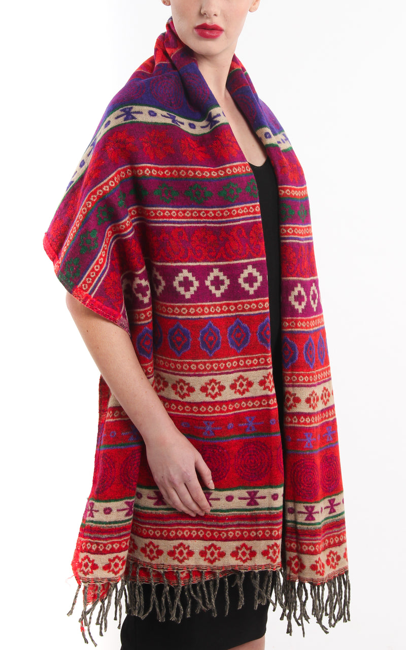 Aztec patterned Red tone blanket warm reversible  tibet shawl draped around shoulders