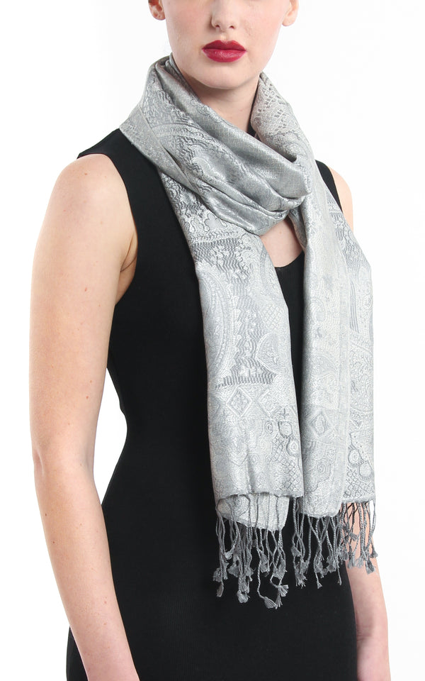 Beautiful light catching silver pure silk pashmina with elegant tassels styled around the neck