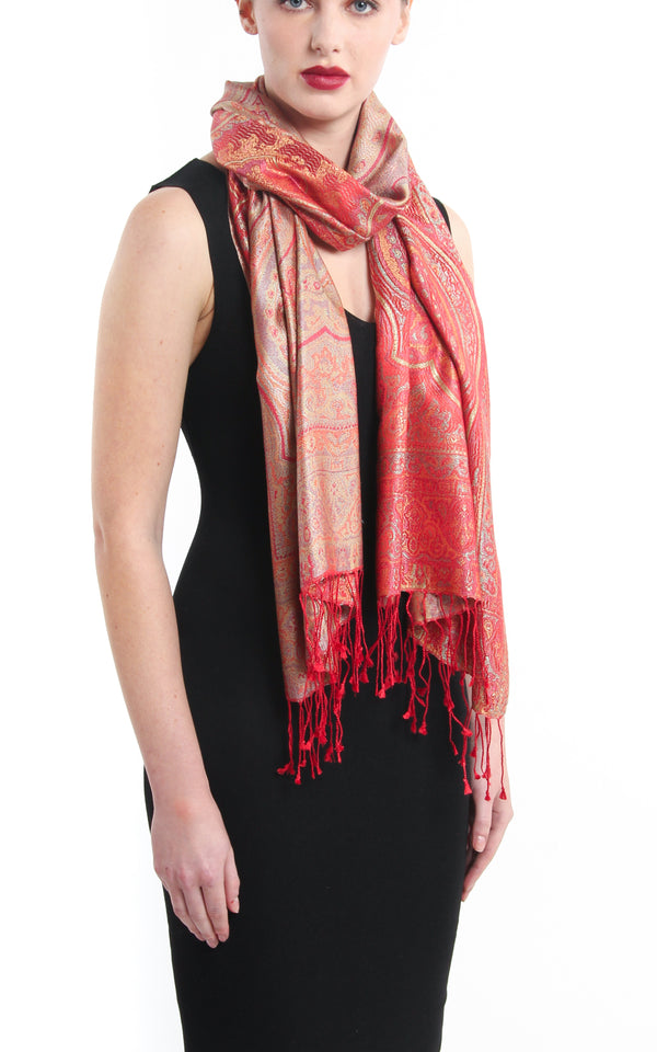 Luxurious cherry red reversible  Pure Silk Pashmina with Paisley pattern styled around the shoulders