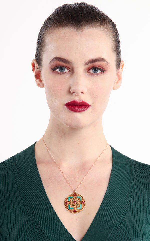 model wearing Geometric Gold Plated Tibetan Mandala Pendant turquoise ruby emerald accents