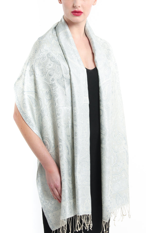 Paisley designed Snowy White pure silk pashmina with tassels around the shoulders