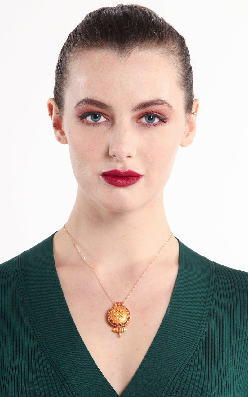 circular Gold Plated Endless Knot auspicious symbol Locket ruby emerald stonesmodel wearing