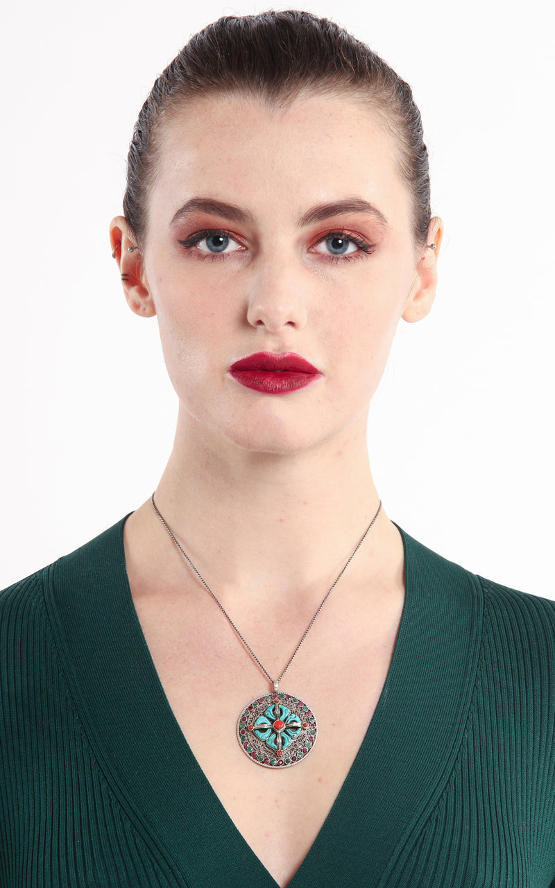 model wearing Silver ruby emerald accents double Thunderbolt Double Dorjee Pendant