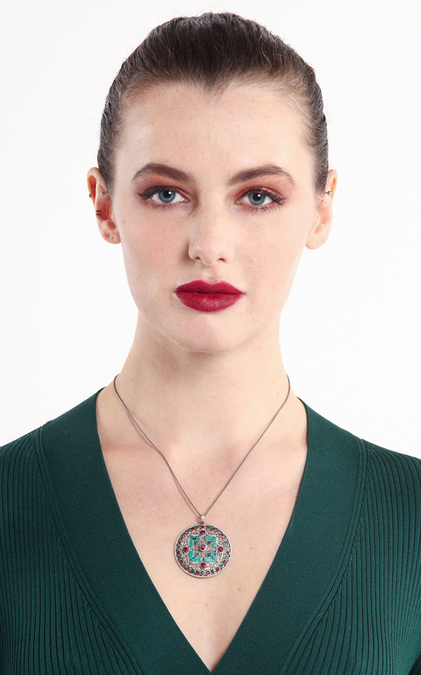 model wearing silver with Turquoise ruby emerald accents  Mandala Pendant