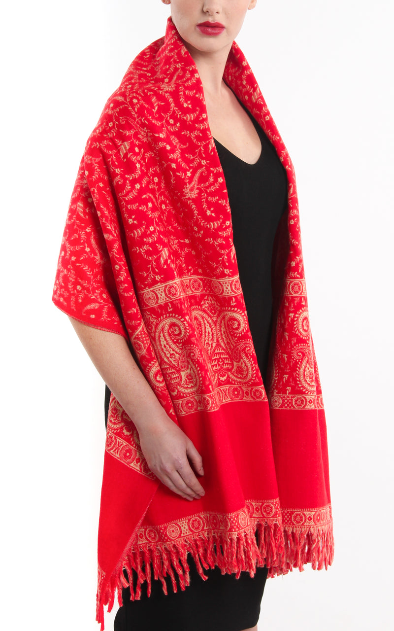 Rosey red orange paisley design chunky knit tibet shawl draped around shoulders