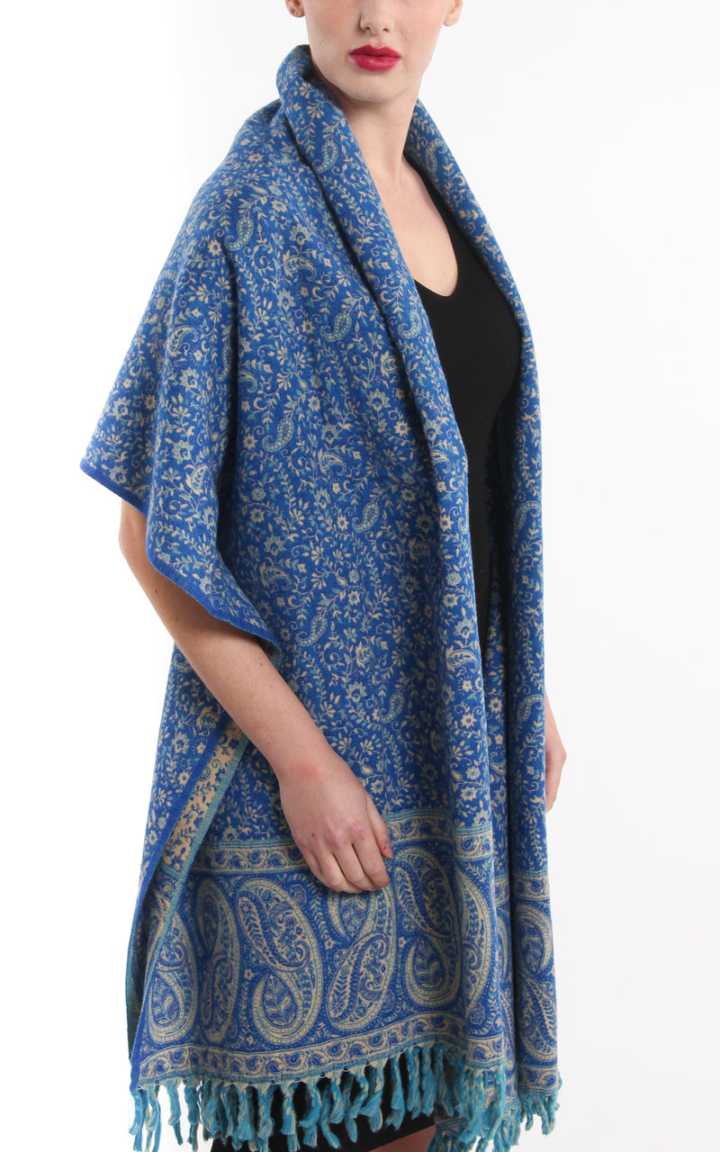 lapis lazuli blue  cream paisley design reversible tibet shawl  tassels draped around shoulders