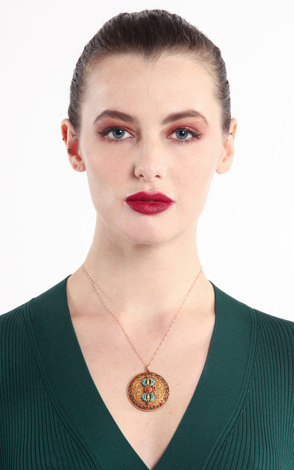 model wearing Circular Gold Dorjee Pendant turquoise coral ruby emerald accents