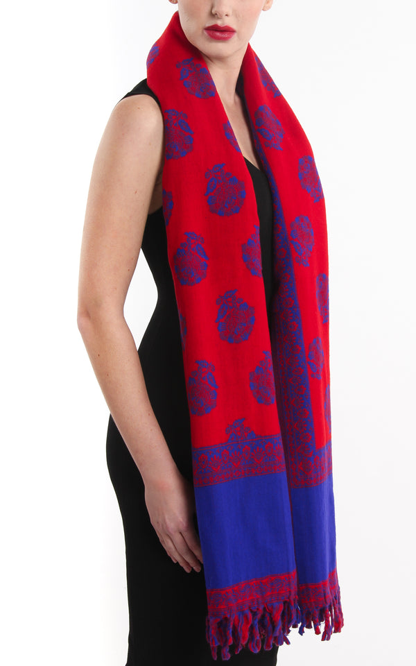 Bright purple and red  with tassels  reversible tibet shawl draped around shoulders