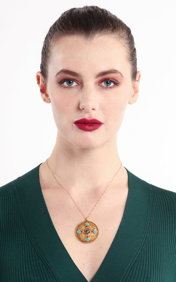 model wearing Circular Unique Gold Mandala Pendant Tibetan handmade jewellery