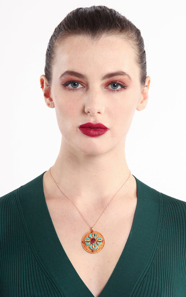 model wearing Circular Gold silver Double Dorjee thunderbolt Pendant turquoise coral ruby accents