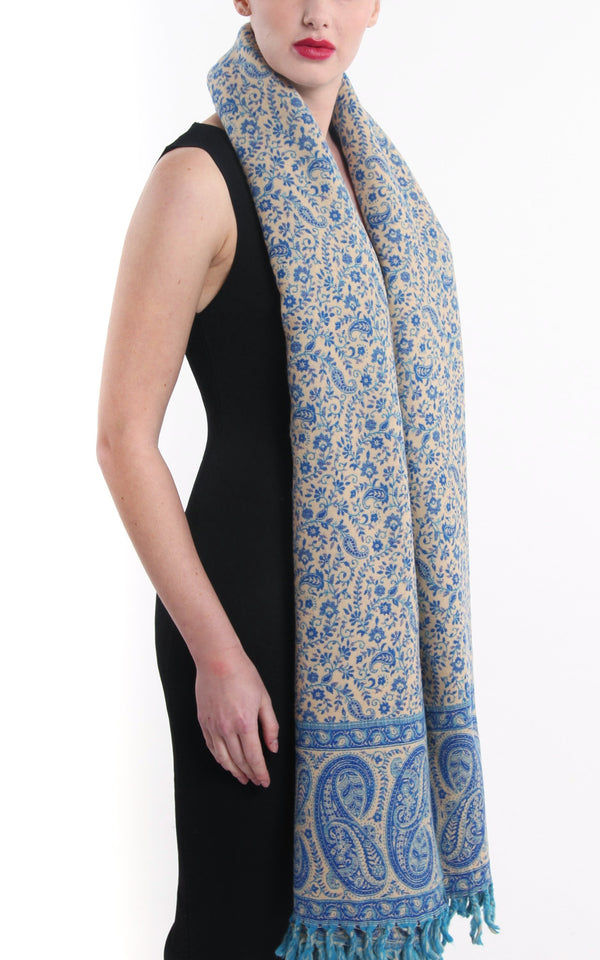 Sea blue paisley designed blanket warm reversible  tibet shawl with cream accents draped around shoulders