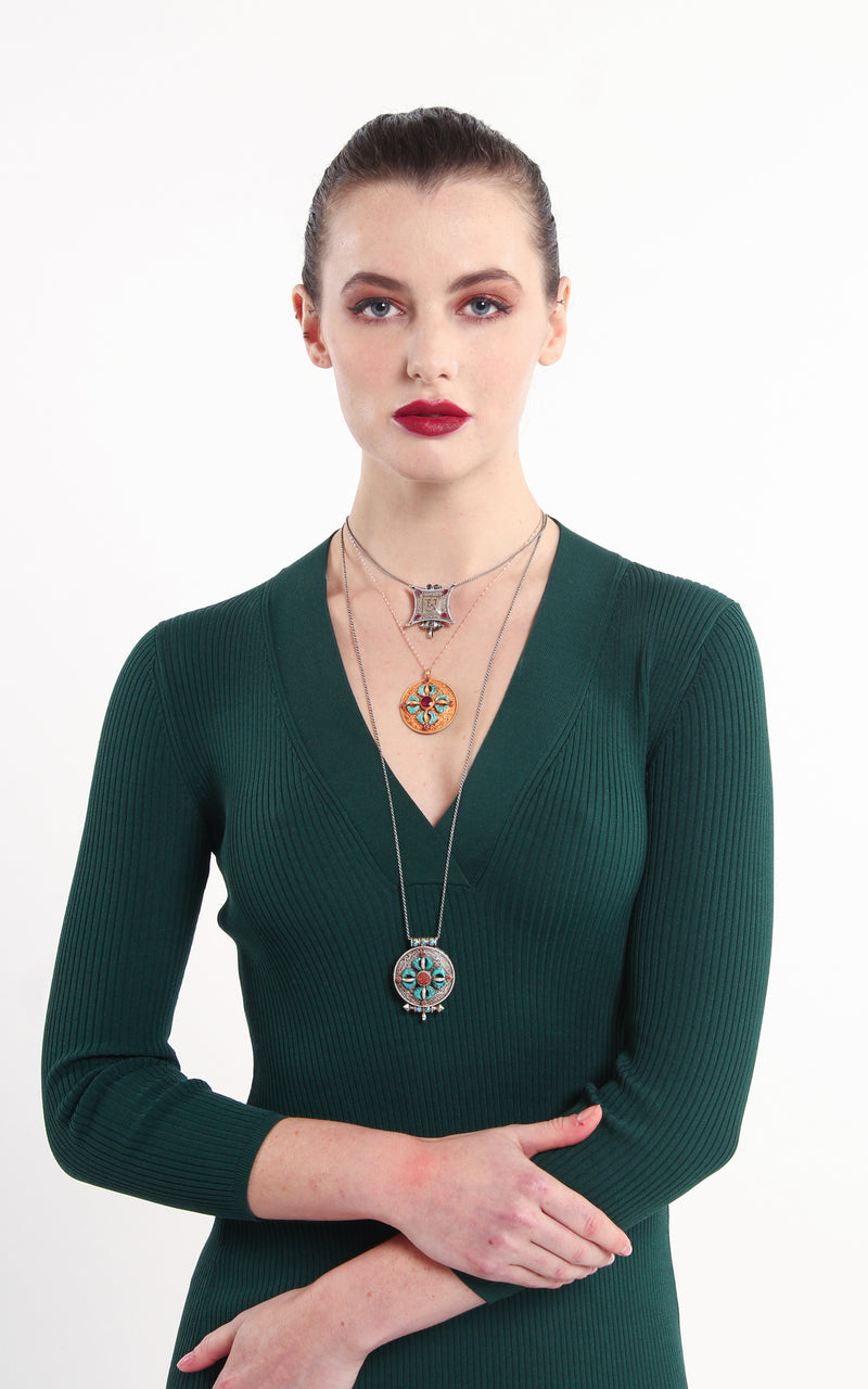 model wearing silver Wheel of time ruby emerald stones Locket Pendant handmade tibetan jewellery