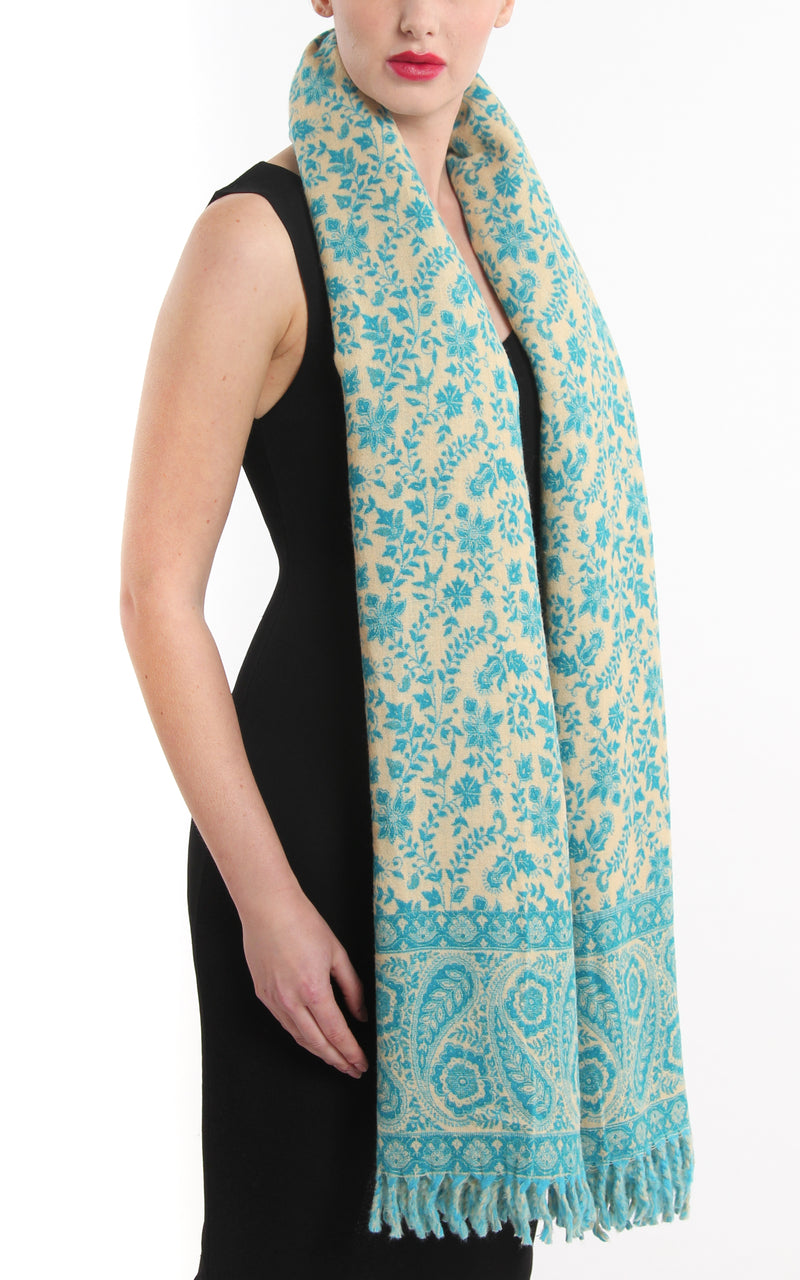 Close up Aqua blue paisley designed cream accents blanket warm reversible  tibet shawl