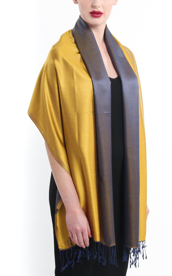 Luxury 100% pure silk regal gold navy blue reversible pashmina draped around shoulders