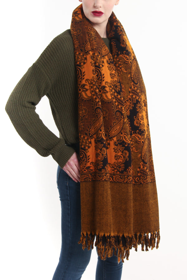orange gold paisley design reversible himalayan tibet shawl  draped around shoulders