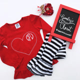 Valentine's Day shirt. Girl's red, ruffle shirt with stitched heart and embroidered monogram.