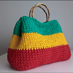 Trelawny  Yardie Scandal bag  Black, Yellow, Green and Red, Gold, and Green. (No Text)