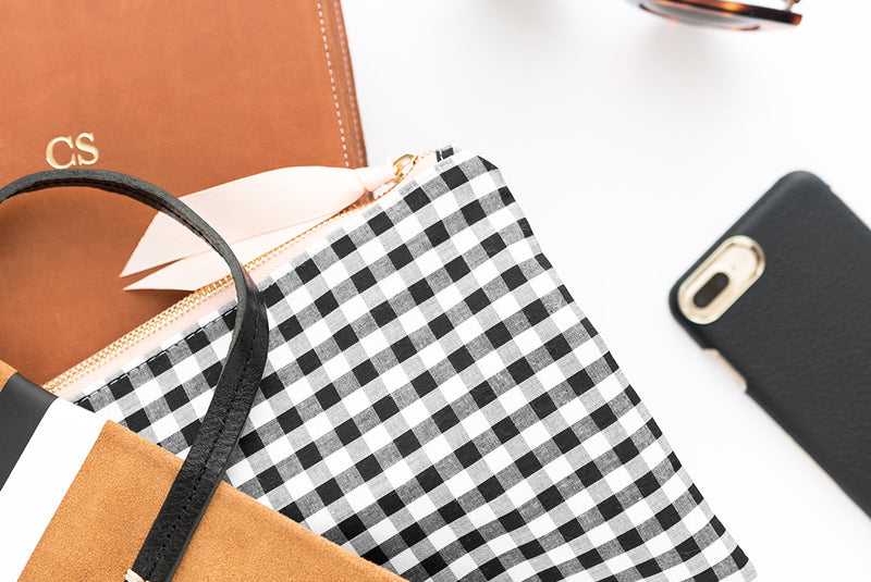 What's In Our Founder's Handbags?