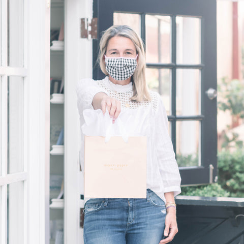 curbside pickup with mask and shopping bag