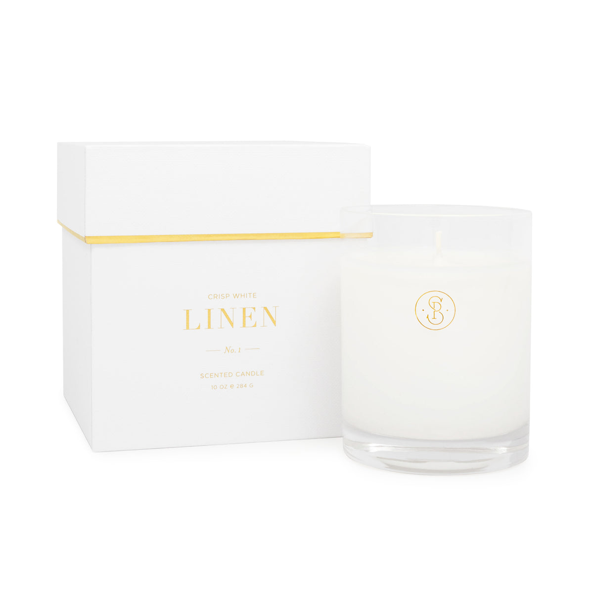 White linen candle with a white box with gold foil detail