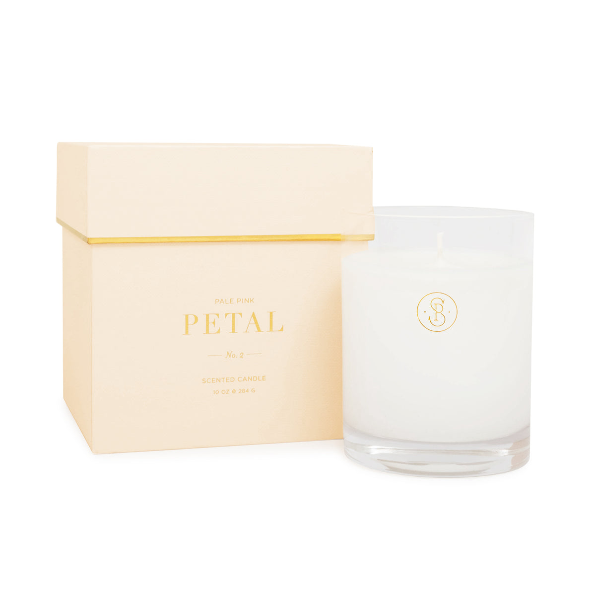 Glass candle next to pink candle box - pale pink petal scent