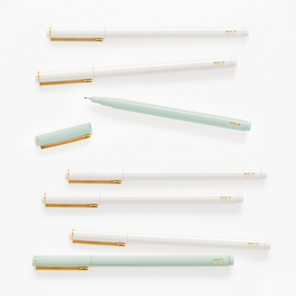 Mint green and white felt tip pens