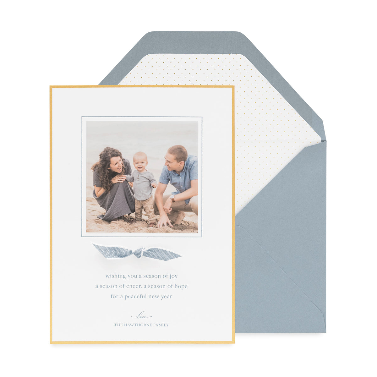 Blue and gold holiday photo card paired with a blue and white ribbon
