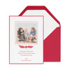 Red holiday photo card with a red and white ribbon