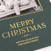 Green holiday photo card with close up detail of Merry Christmas in gold foil