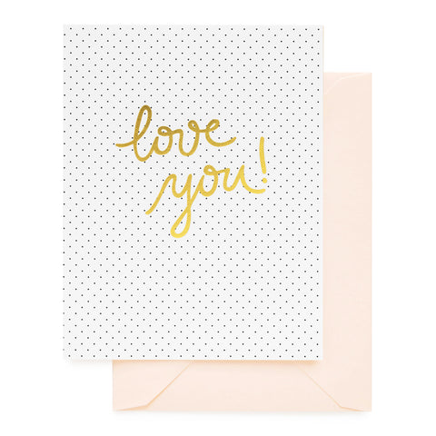 Black pindots on white folded card printed with gold love you