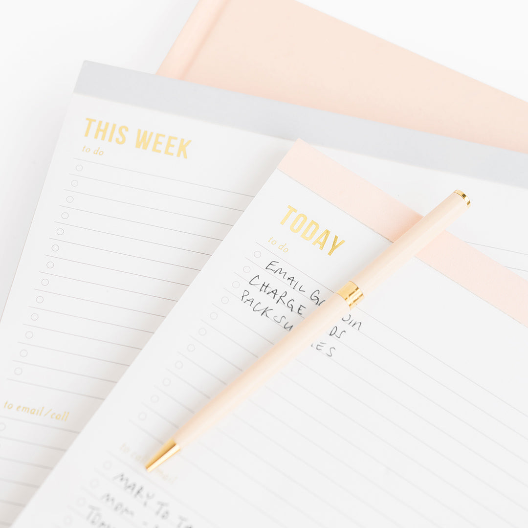 Stack of grey and pale pink planning pads - weekly and today.