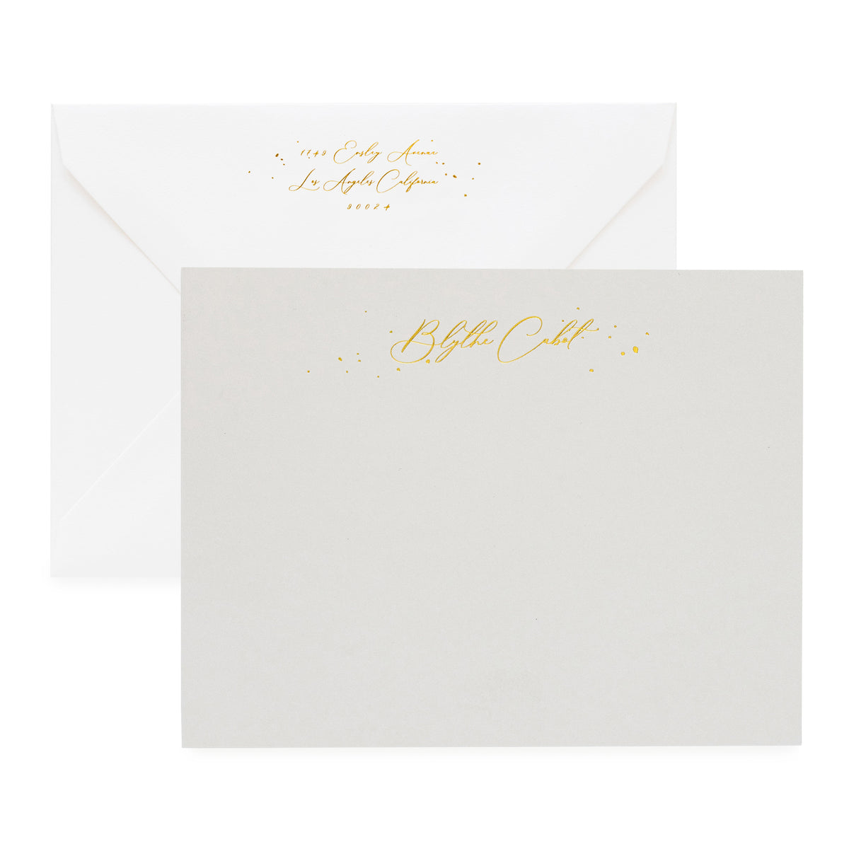 Grey stationery set with gold foil script name and gold return address detail