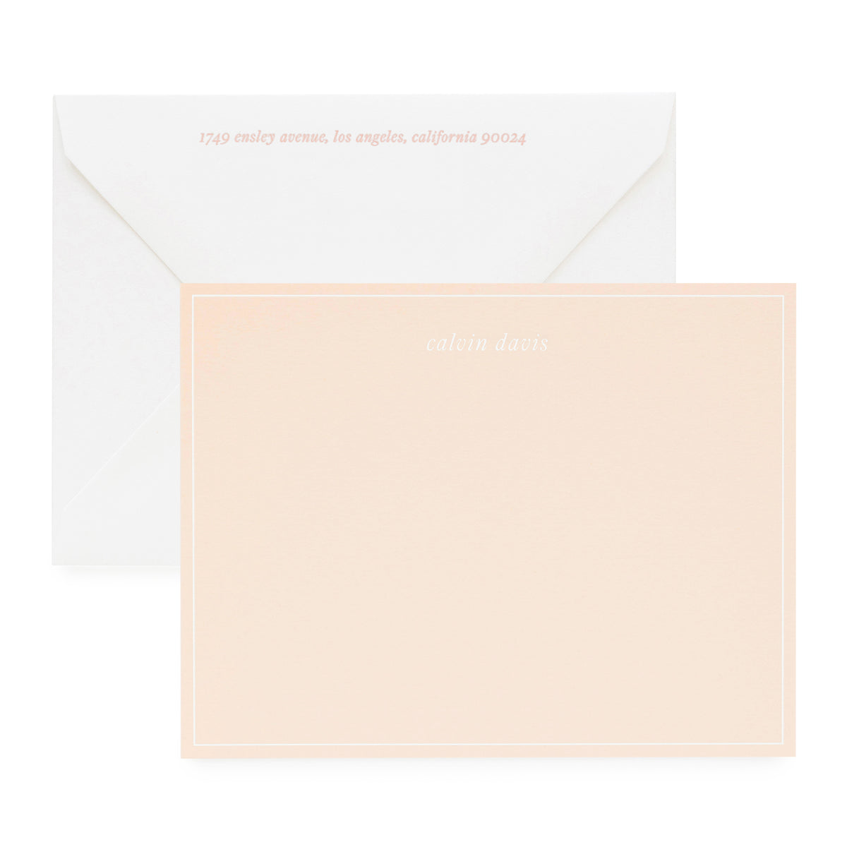 Pale pink stationery set with pink letterpress return address on envelope