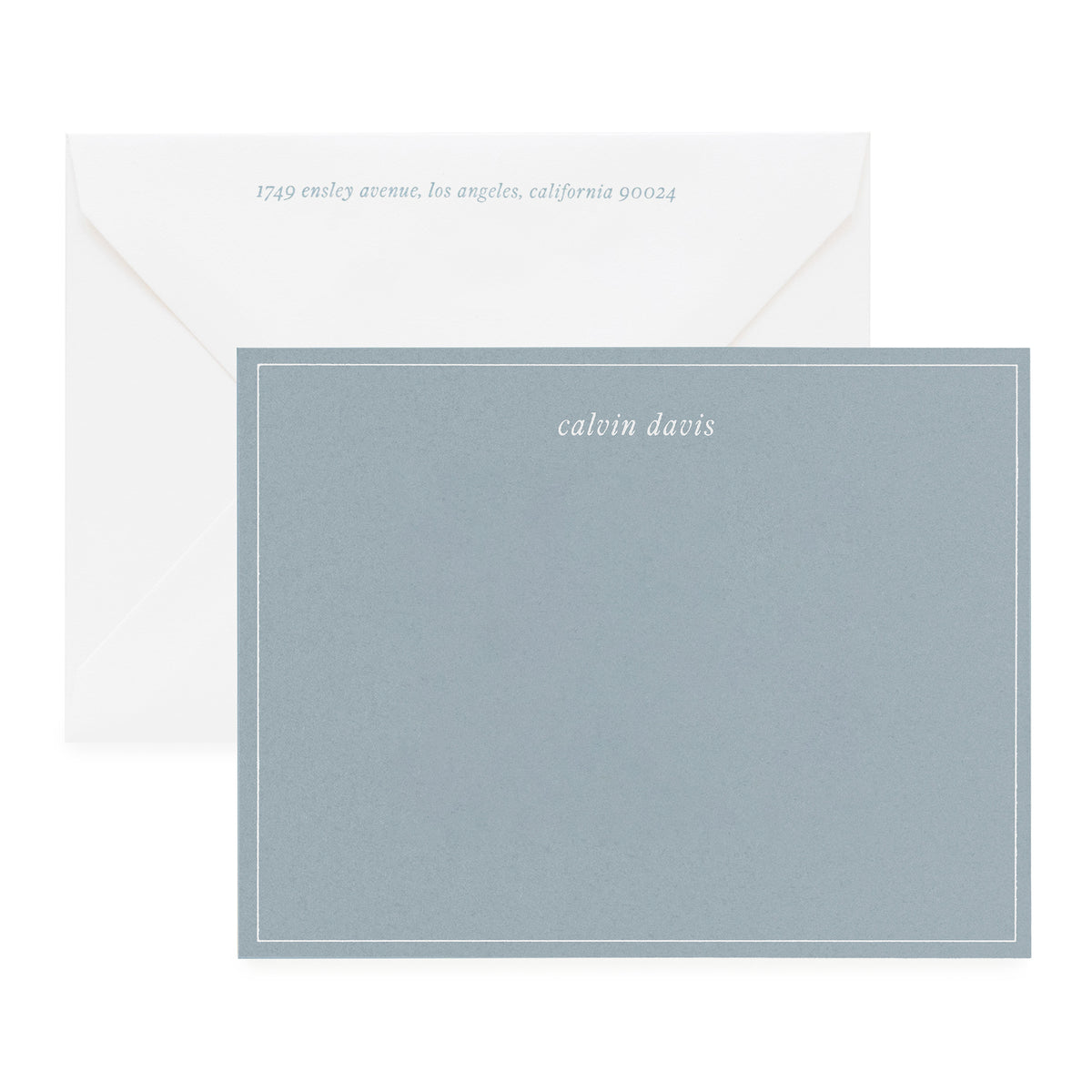 Slate blue stationery set with blue notecard with white ink and blue ink on white envelope
