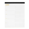 This Week notepad with black binding and gold foil details