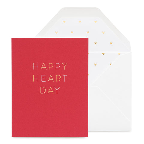 Red card printed in white and gold foil with Happy Heart Day with a heart gold foil liner