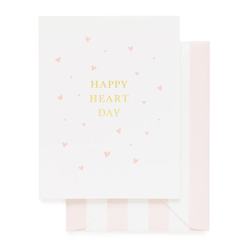 White card printed with Happy Heart day in gold foil and pink hearts