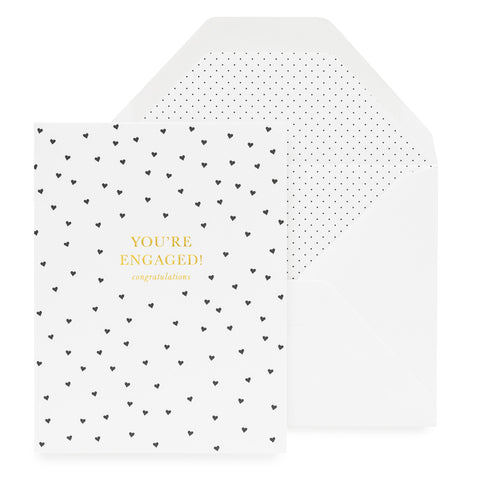 White folded card with black hearts and printed with You're Engaged, Congratulations.
