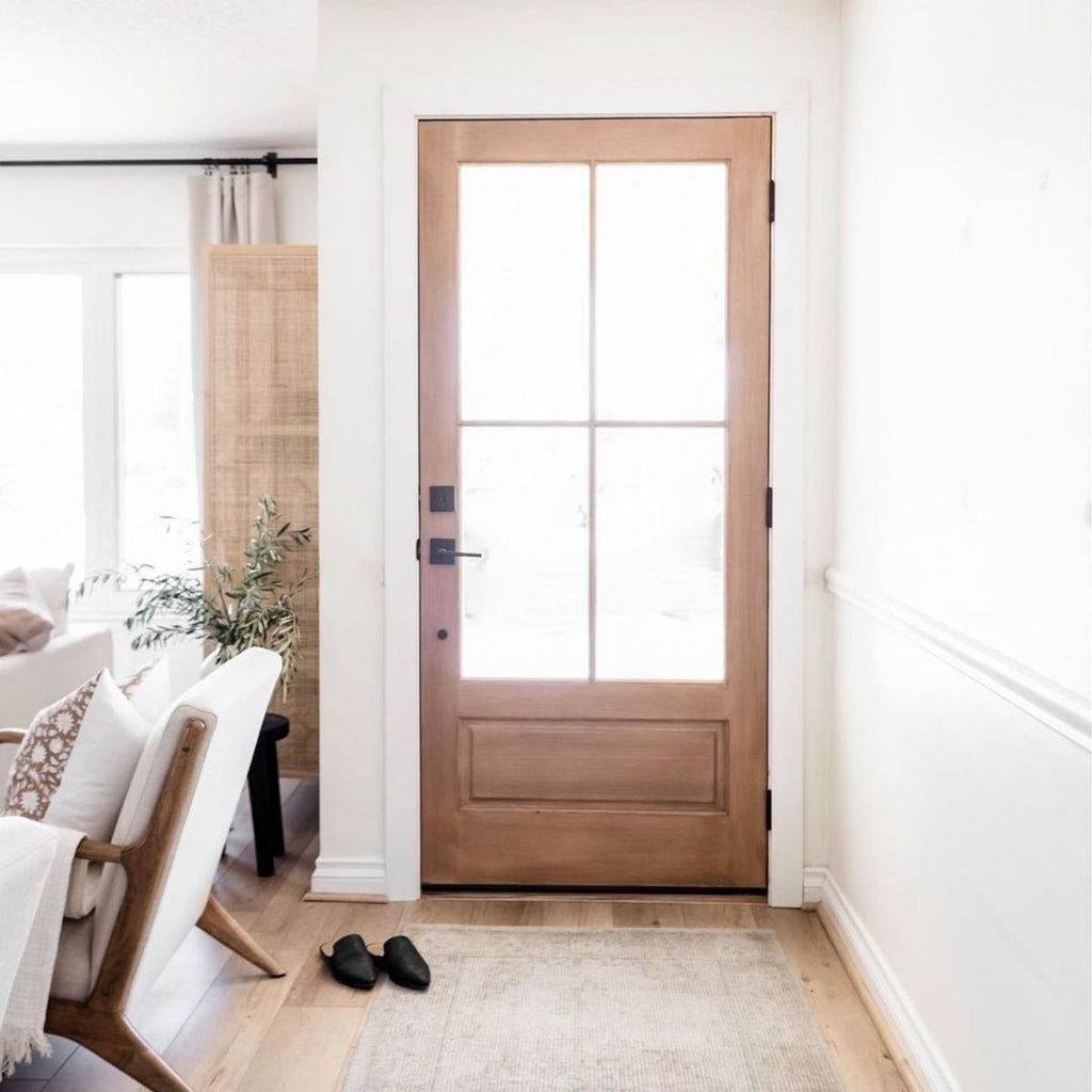 white walls with wood french door