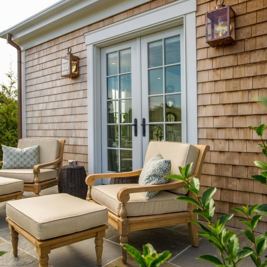 light brown exterior home with white french doors