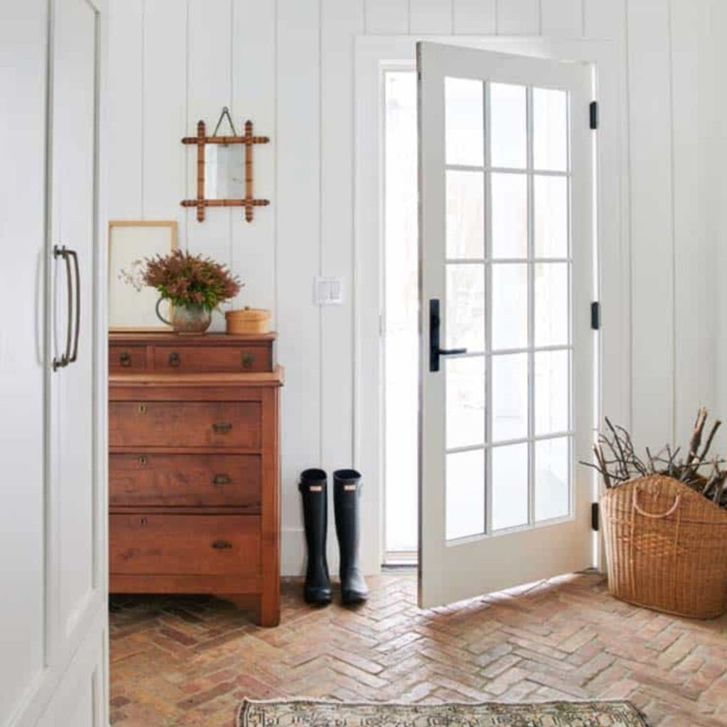 white walls with brick floor and white french door