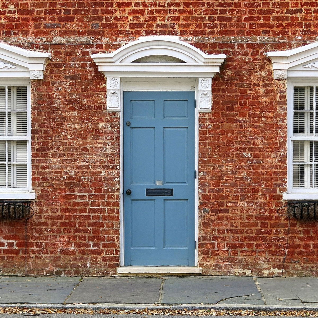 red brick house with light blue door