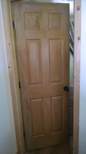 door in cabin before buying knotty pine door