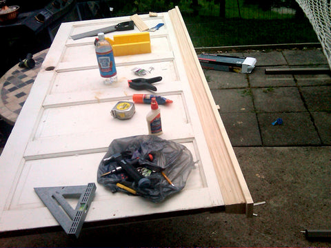 tools on shaker style door being turned into headboard
