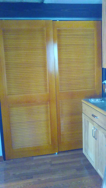 dtd louver door used to cover hot water heater in kitchen