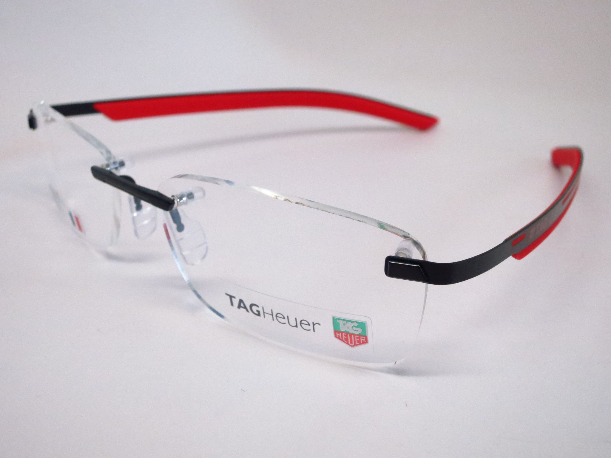 03cb10b68e Tag Heuer TH 3843 002 Red   Black Line Rimless Eyeglasses - Eye Heart  Shades ...