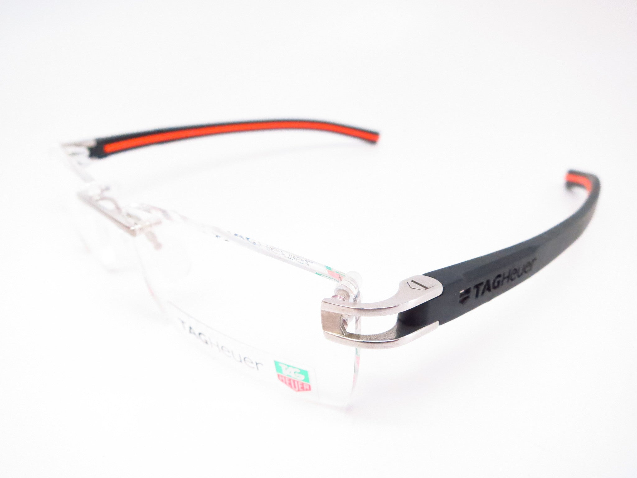 c9bf1f93bb Tag Heuer TH 7641 004 Black   Orange Track-S Rimless Eyeglasses - Eye Heart  ...